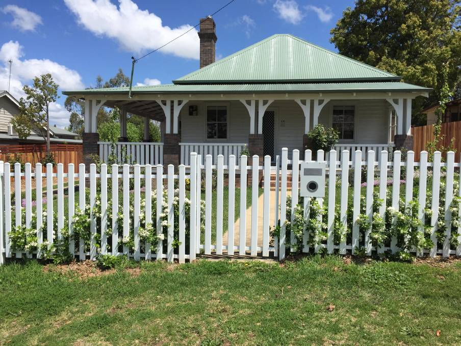 AFTER: When buying a fence, choose a style in keeping with your home. Go for subtle tones of flowers for your garden if planting against a plain white backdrop. Match the letterbox with the fencing and keep it clear of promotional pamphlets.