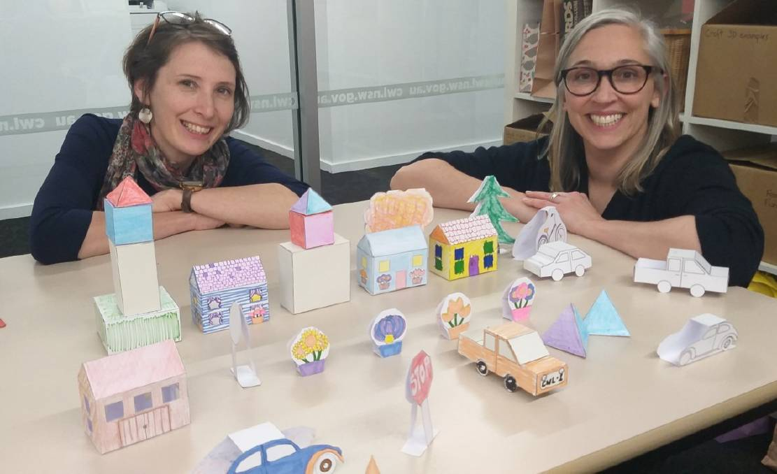 Librarians Bek Salmon and Alex Gibb with the City Project for the school holidays.
