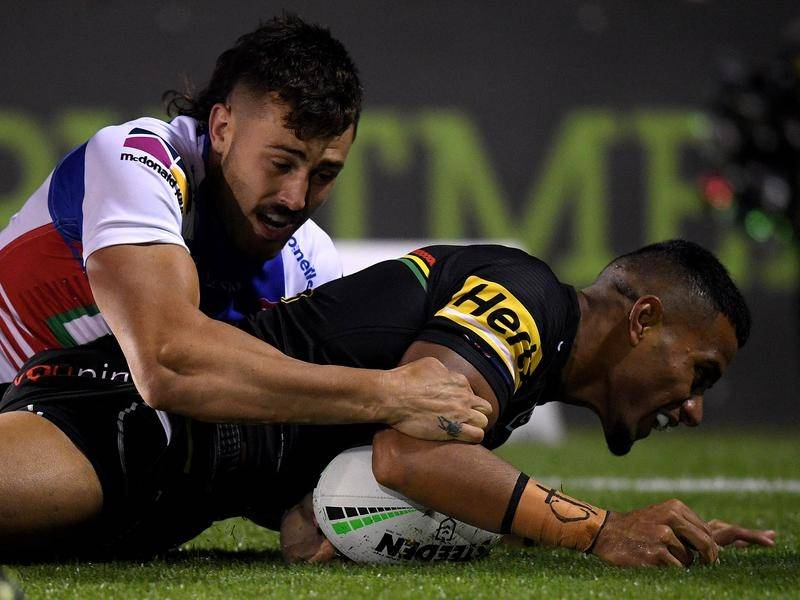 Stephen Crichton scores Penrith's opening try in Thursday's 24-6 win over the Newcastle Knights.